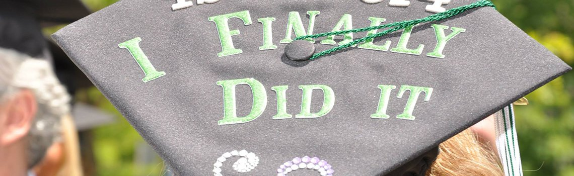 'I Finally Did It' on a graduation cap