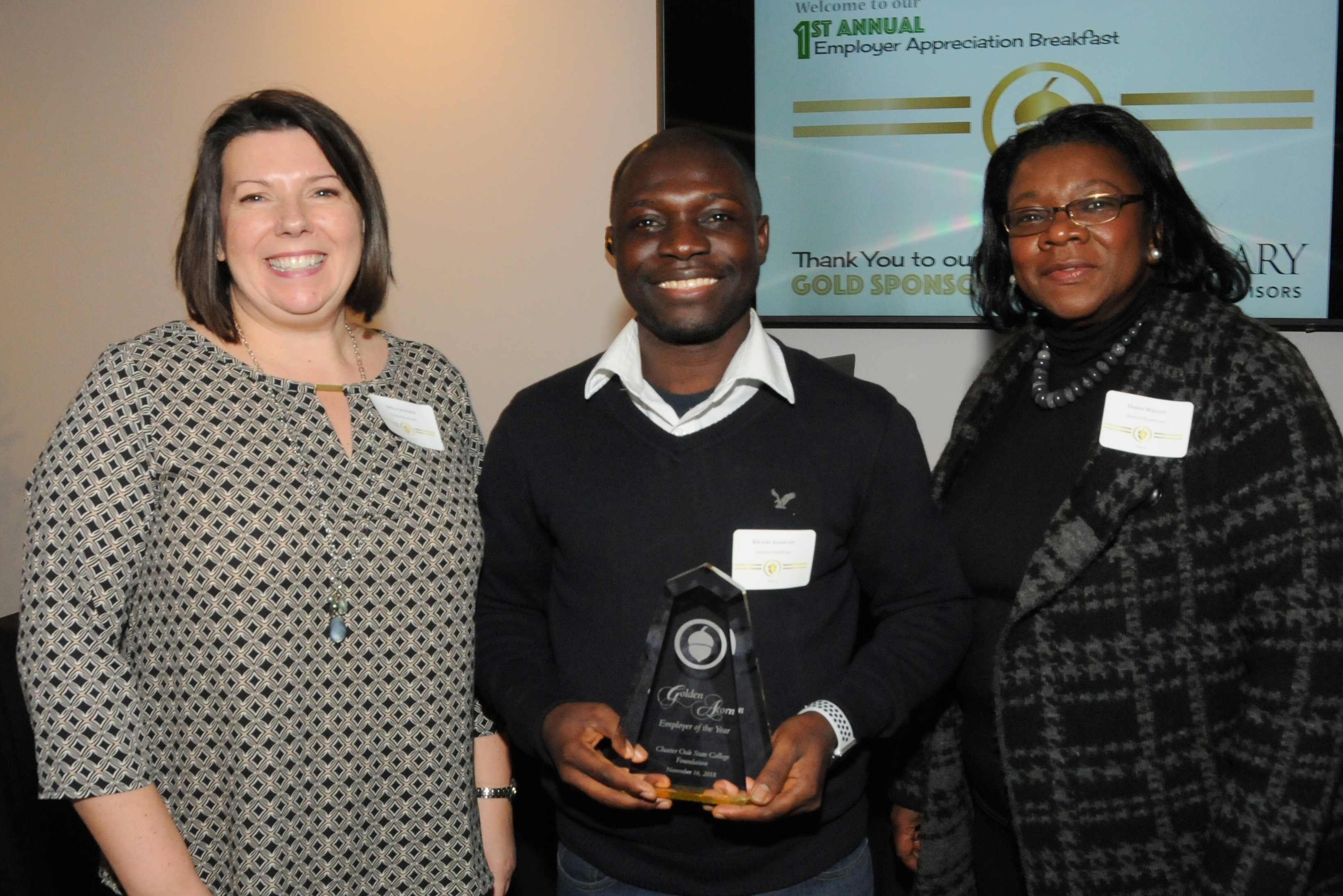 The 2018 Golden Acorn Employer of the Year - Hartford Healthcare!  From left to right, Shelly Johnson, Kwame Asamoah, COSC Student and Scholarship Recipient, Debbi Wright, RHIA, System Director of Health Information Management and Guest Speaker. (Missing from the picture is supervisor, Celia Rodriguez.)