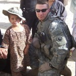 Bryan Kowalsky - 2010 Dingwall Scholarship Recipient. This picture is of Bryan during his deployment in Afghanistan. He is with an Afghan girl wearing his boonie cap.