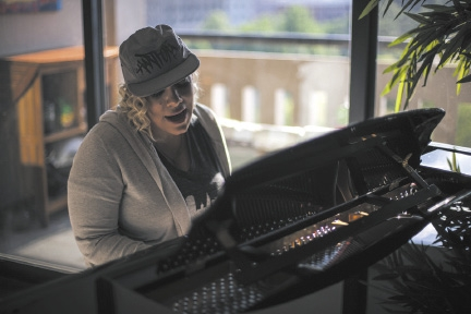 Trudi Lebron playing piano